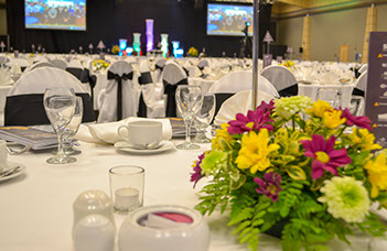 Corporate event with arranged table and audio visual