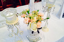 Special wedding event table with crystal candle holders and flowers