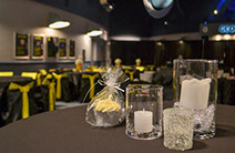 Special event with crystal on table and yellow black accents.