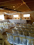 Decorated event with white chair coverings