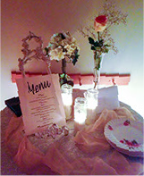 Social evetn table setting with menu and flowers